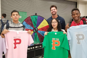 "Students displaying shirts during ""Spin the Wheel"" Game"