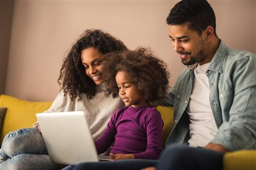 Parents with child on laptop
